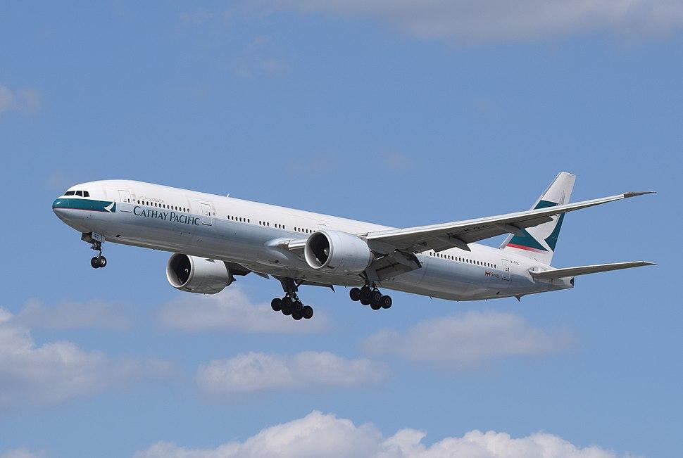 Cathay Pacific Boeing 777-300ER (B-KQC) arrives London Heathrow 7Jun2015 arp