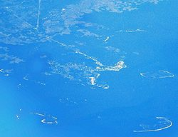 Aerial view of Cedar Key and its outlying islands, illustrating the extremely small size of the city.  The fork at State Roads 24 and 347 (the only two access roads) can be seen in the upper left.
