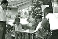 Children selling lemonade to an adult in La Canada, California, 1960.jpg