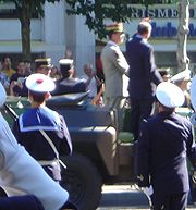 While Jacques Chirac was reviewing troops in a motorcade such as this one on Bastille Day 2002, he was shot at by a bystander.
