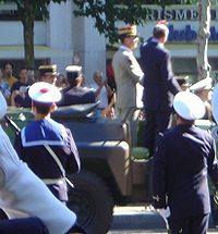 While Jacques Chirac was reviewing troops in a motorcade such as this one on Bastille Day 2002, he was shot at by a deranged bystander.