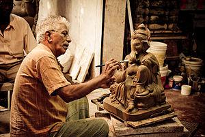 Ganesh Chaturthi - Artist preparing Ganesha's image for the festival in Margao, Goa