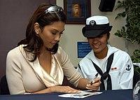 "Cielito ""Pops"" Fernandez signs an autograph.jpg"
