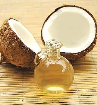 Coconut oil - A cracked coconut and a bottle of coconut oil