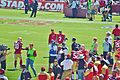 Colin Kaepernick and Kyle Williams warm up.jpg