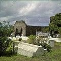 Collectie Nationaal Museum van Wereldculturen TM-20030070 Begraafplaats met oude graven en ruines van de uit 1774 daterende Nederlands Hervormde Kerk Sint Eustatius Boy Lawson (Fotograaf).jpg