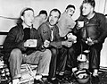 Crewmen on USS Boston (CA-69) eating after repelling enemy air attack off Formosa, 14 October 1944 (80-G-272639).jpg