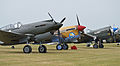 Curtiss P-40 line-up - 2013 Flying Legends (14140839834).jpg