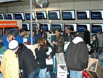 Consumer electronics - A crowd of shoppers in the flatscreen TV section of the big box consumer electronics store Best Buy