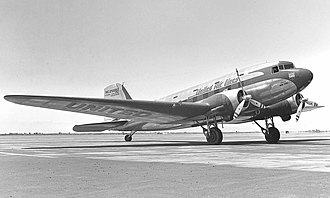 Douglas DC-3 - A Douglas Sleeper Transport (DST). DSTs were built with a second row of windows for the upper bunk beds, visible above the airline titles