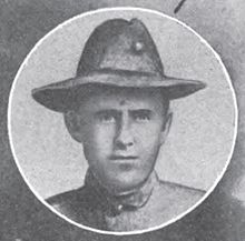 Round portrait of a young man wearing a military hat and jacket.