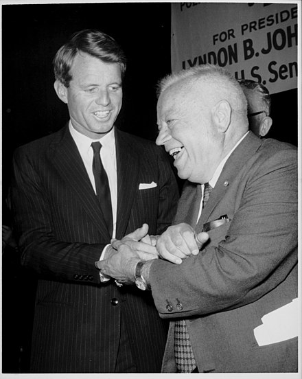 "Robert Kennedy with David Dubinsky in an undated photo. The sign in the background reads, ""For President - Lyndon B. Johnson"". David Dubinsky with Robert F. Kennedy; sign in background reads, in part, ""For President- Lyndon B. Johnson."".jpg"