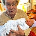 Deborah Hanan holding grandson.jpg