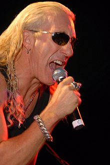 Snider singing into a microphone