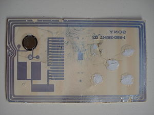 FeliCa - A defaced FeliCa (EZ-Link) card, revealing its internal circuitry.