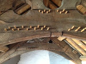 "Plas Mawr -  The roof above the great chamber, with arch-braced collar trusses joined using ""double pegging"""