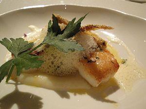 Foam (culinary) - Parmesan foam on a dinner entree