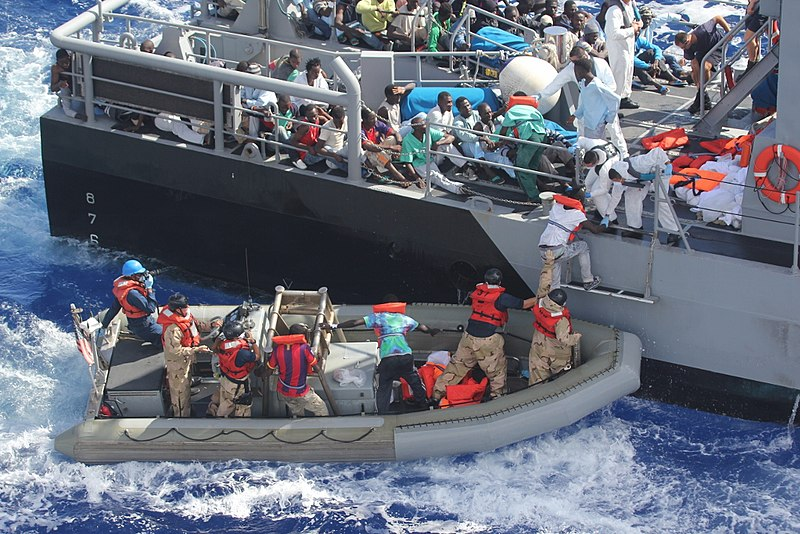 File:Distressed persons are transferred to a Maltese patrol vessel..jpg