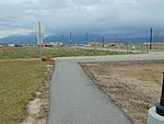East along walkway from South Jordan Parkway station, Apr 16.jpg