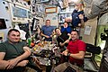 Expedition 60 crew together for dinner inside the Zvezda service module.jpg