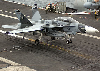 Tactical Support Wing - F/A-18B of VFC-12 landing on the USS Ronald Reagan in 2005