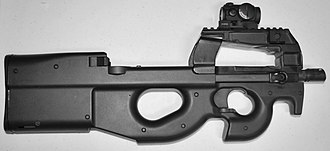 Bullpup - The FN P90 uses the bullpup layout in conjunction with a unique top-mounted feeding system, making it the most compact personal defense weapon with a fixed stock