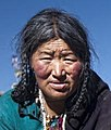 Face detail (left), Tibet & Nepal (5179907827) (cropped).jpg