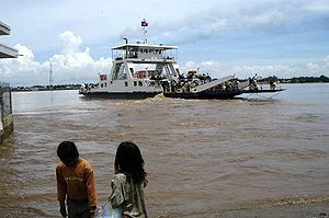 A Mekong ferry takes vehicles and passengers across the Mekong to Neak Loeung town