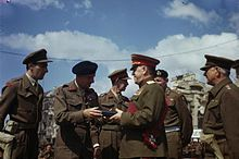 Field Marshal Montgomery Decorates Russian Generals at the Brandenburg Gate in Berlin, Germany, 12 July 1945 TR2908.jpg