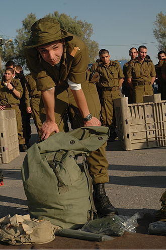 Conscription in Israel - Image: Flickr Israel Defense Forces A New Soldier Packs His Bag