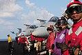 Flight deck crewmen watch as an F-A-18 Hornet launches from the flight deck of the aircraft carrier USS Dwight D. Eisenhower (CVN 69) as the ship conducts flight operations in the Arabian Sea on Nov 121125-N-NB538-105.jpg