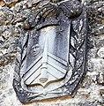 Fortezza delle Verrucole mura con bastioni particolare stemma all'ingresso.jpg
