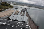 Forward gun turrets of the USS Missouri USS Arizona Memorial in the background.JPG