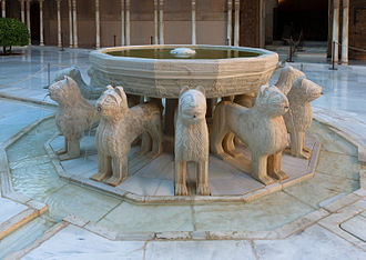 Islamic garden - (1362) Court of the Lions, Grenada, Spain. Fountain depicting lions with water coming out of their mouths