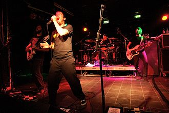 Funeral for a Friend - Guitarist Kris Coombs-Roberts (left), Matthew Davies-Kreye (front), former drummer Ryan Richards (background) and former bassist Gareth Davies (right) performing in 2007