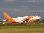 G-EZFA easyJet Airbus A319-111 landing at Schiphol (EHAM-AMS) runway 18R pic4.JPG