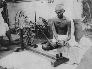 Indian National Congress - Mahatma Gandhi spinning yarn, in the late 1920s