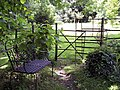 Gate and chair in All Saints Churchyard - geograph.org.uk - 454829.jpg