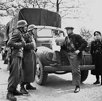 Feldgendarmerie - Feldgendarmerie guard a food truck in the Netherlands in 1945.