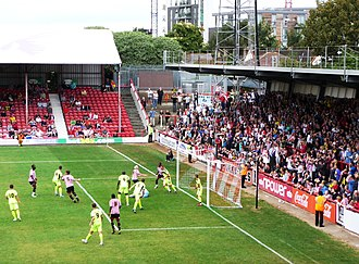 Griffin Park - Brentford and Yeovil Town contesting a corner in front of the roofed Ealing Road stand in August 2011.