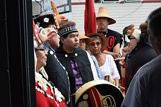 Haida people - Haida wait for their Heiltsuk hosts to welcome them to sing and dance at a peace potlatch in Waglisla.