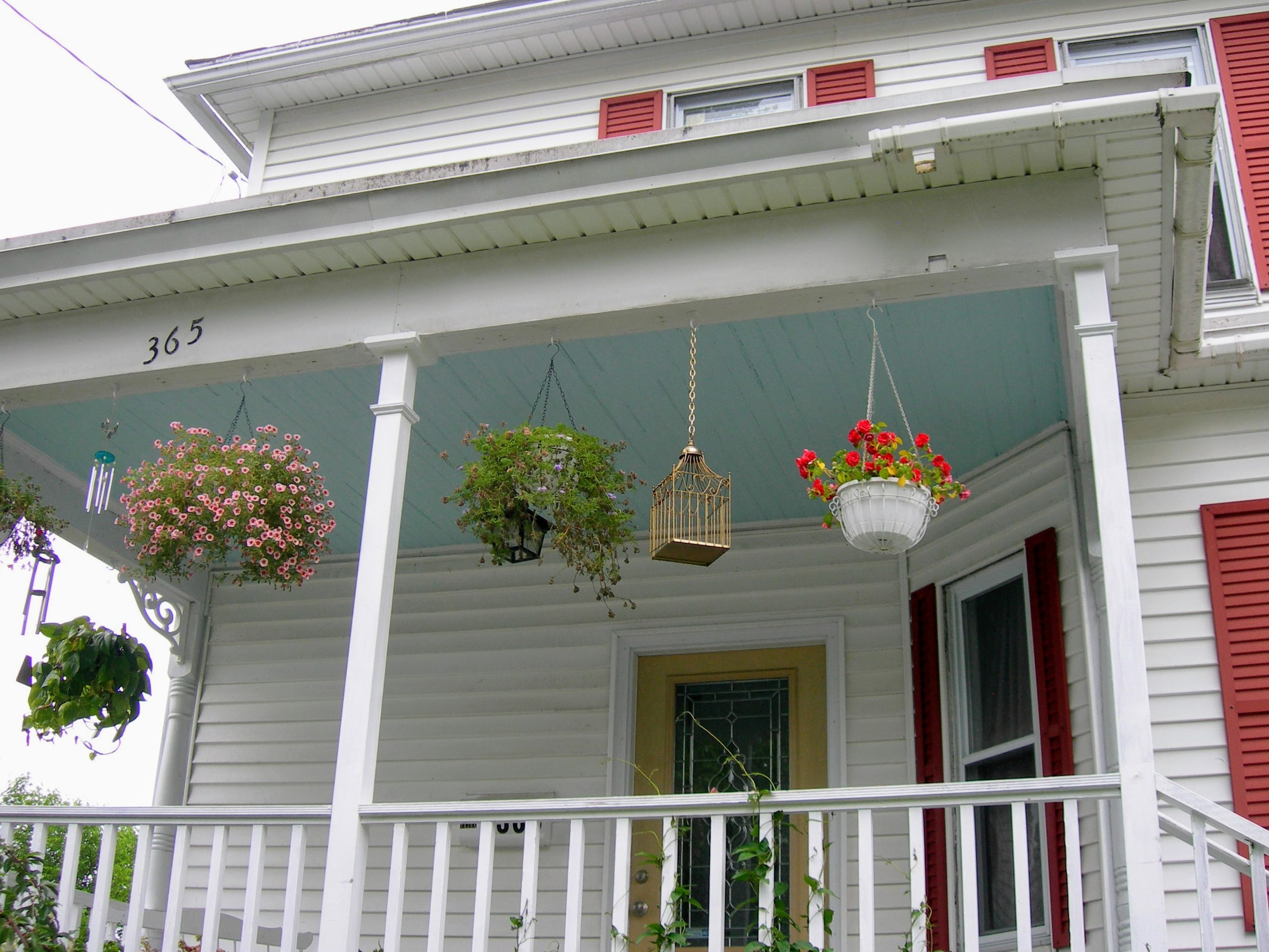 A photograph of Haint Blue paint on the porch of an American house.