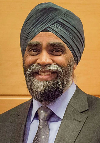 Turban - Harjit Singh Sajjan, the Minister of National Defence of Canada wearing a Sikh turban. The turban is one of the most recognized symbols of the Sikh community.