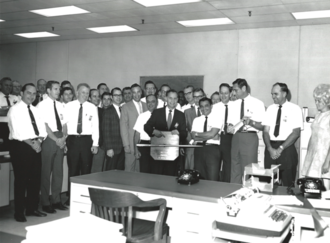 Harry Dornbrand - Harry Dornbrand receiving an unofficial award from colleagues at Fairchild Space and Electronics division after the team met the deadline for delivering the proposal for the ATS-6 satellite to NASA, in 1969.