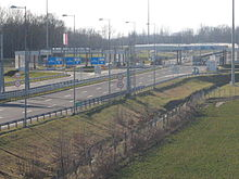 Highway border crossing, with toll booths