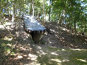 Holtun - The covered looters' trench cut into Structure A2