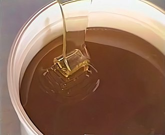 Reynolds number - The high viscosity of honey results in perfectly laminar flow when poured from a bucket, while the low surface tension allows it to remain sheet-like even after reaching the fluid below. Analogous to turbulence, when the flow meets resistance it slows and begins oscillating back and forth, piling upon itself.