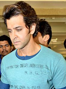 Hrithik Roshan is looking to his right.