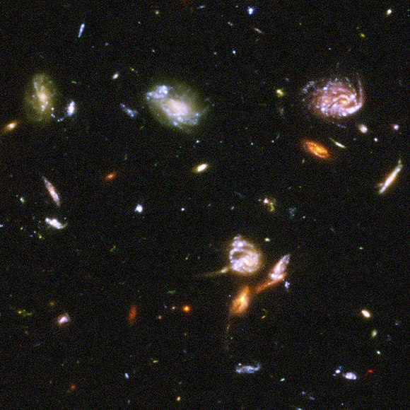 Part of the Hubble Ultra-Deep Field image showing a typical section of space containing galaxies interspersed by deep vacuum. Given the finite speed of light, this view covers the past 13 billion years of the history of outer space. Hubble Ultra Deep Field part d.jpg