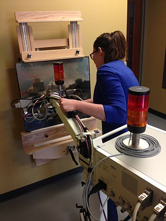 Conservation scientist - Caitlyn Phipps using micro X-ray fluorescence(XRF) Spectroscopy at the Indianapolis Museum of Art